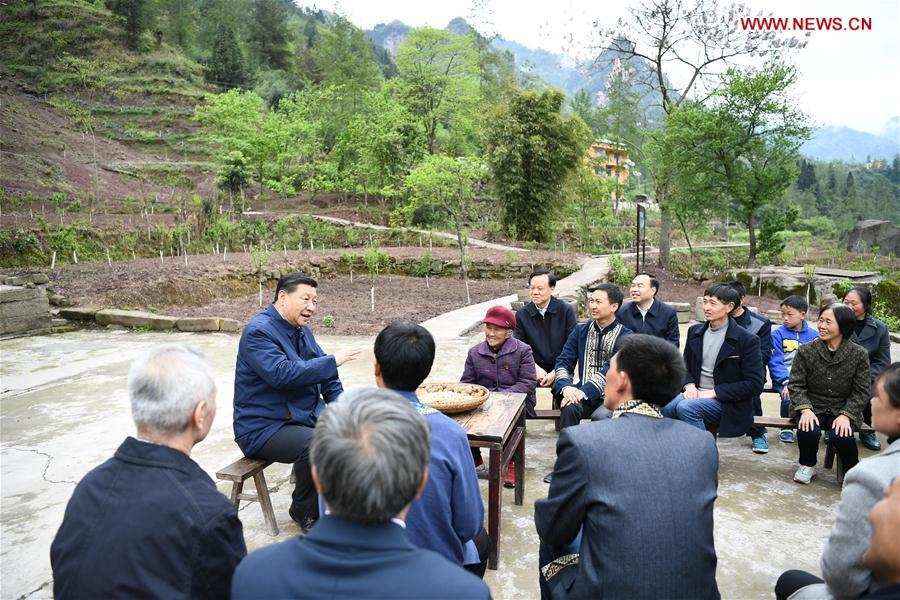 Chinese President Xi Jinping, also general secretary of the Communist Party of China Central Committee and chairman of the Central Military Commission, talks with villagers to learn about the progress of poverty alleviation and in solving prominent problems including meeting the basic need of food and clothing and guaranteeing compulsory education, basic medical care and safe housing, in Huaxi Village of Shizhu Tujia Autonomous County, southwest China\'s Chongqing, April 15, 2019. Xi went on an inspection tour in southwest China\'s Chongqing Municipality Monday. (Xinhua/Xie Huanchi)