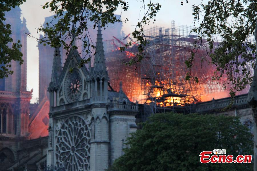 The Notre Dame Cathedral is on fire in central Paris, capital of France, on April 15, 2019. A blaze broke out on Monday afternoon at the Notre Dame Cathedral in central Paris. (Photo/China News Service)