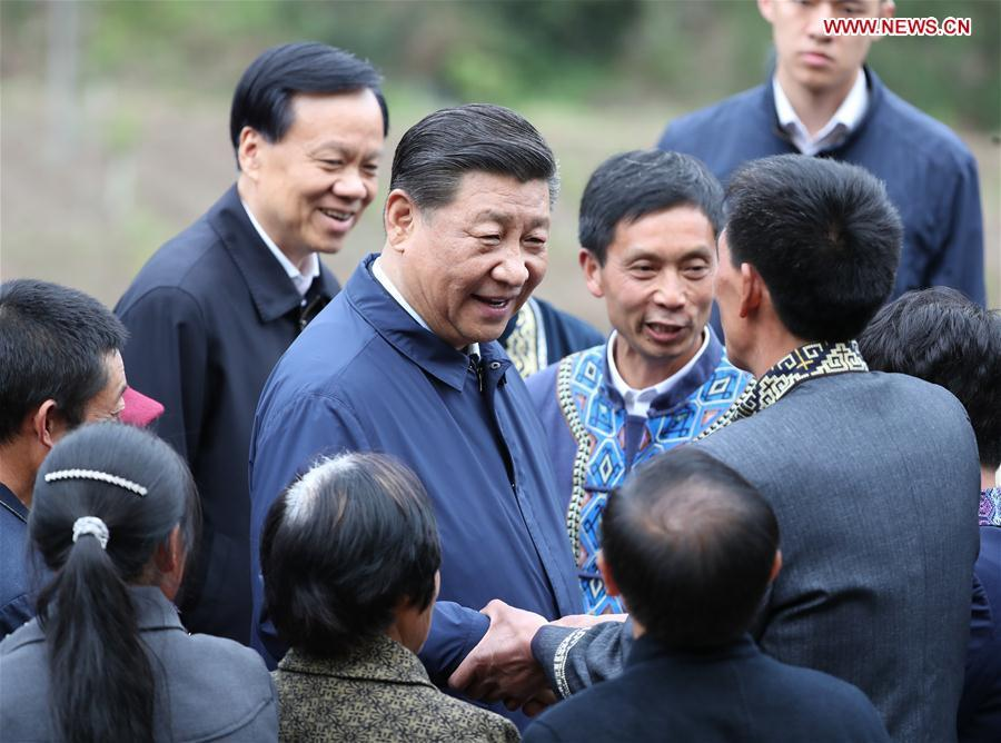 Chinese President Xi Jinping, also general secretary of the Communist Party of China Central Committee and chairman of the Central Military Commission, talks with villagers in Huaxi Village of Shizhu Tujia Autonomous County, southwest China\'s Chongqing, April 15, 2019. Xi went on an inspection tour in southwest China\'s Chongqing Municipality Monday. (Xinhua/Ding Haitao)