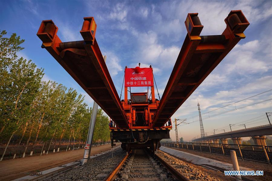 Builders of China Railway 12th Bureau Group operate machine to lay tracks at the construction site of the Liying section of the Beijing-Xiongan intercity railway, April 15, 2019. Track-laying work of the Beijing-Xiongan intercity railway began on Monday. (Xinhua/Xing Guangli)