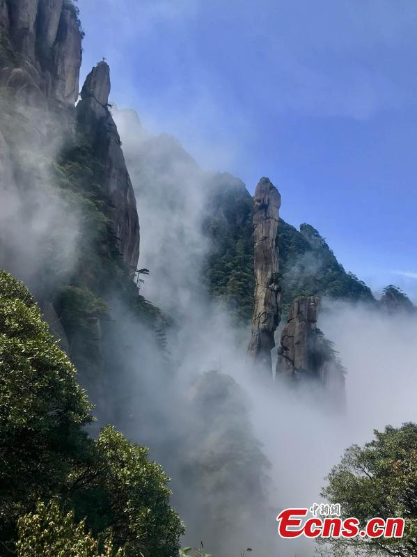 Clouds surround Mount Sanqing in Jiangxi Province. Mount Sanqing National Park is a UNESCO world heritage site, known for its exceptional scenic quality, marked by a concentration of fantastically shaped pillars and peaks. (Photo: China News Service/Lin Min)