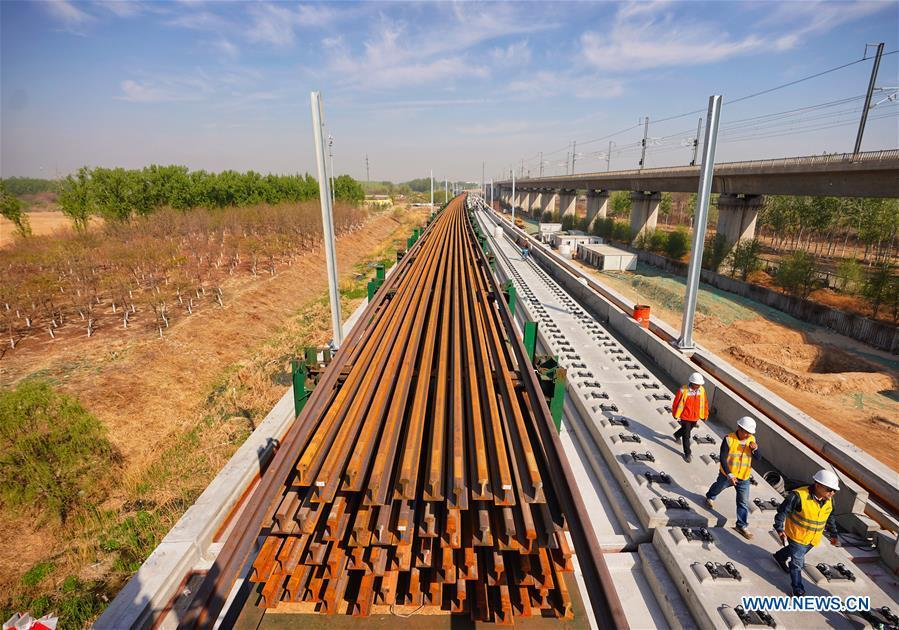 Builders of China Railway 12th Bureau Group work on the Liying section of the Beijing-Xiongan intercity railway, April 15, 2019. Track-laying work of the Beijing-Xiongan intercity railway began on Monday. (Xinhua/Xing Guangli)
