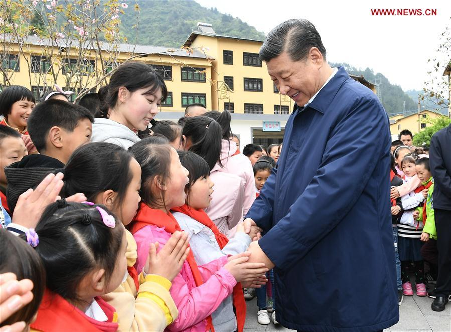 Chinese President Xi Jinping, also general secretary of the Communist Party of China Central Committee and chairman of the Central Military Commission, talks with students at a primary school in Zhongyi Township of Shizhu Tujia Autonomous County, southwest China\'s Chongqing, April 15, 2019. Xi went on an inspection tour in southwest China\'s Chongqing Municipality Monday. (Xinhua/Xie Huanchi)