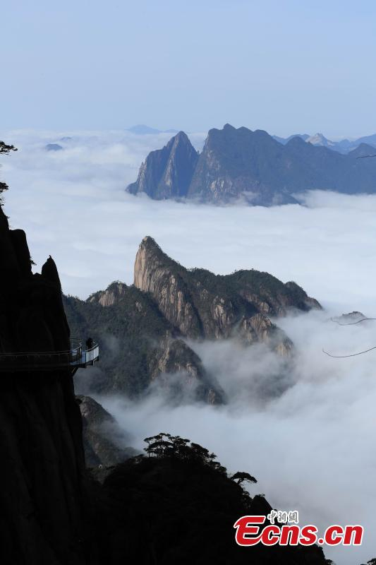 Clouds surround Mount Sanqing in Jiangxi Province. Mount Sanqing National Park is a UNESCO world heritage site, known for its exceptional scenic quality, marked by a concentration of fantastically shaped pillars and peaks. (Photo: China News Service/Zhang Hezhong)