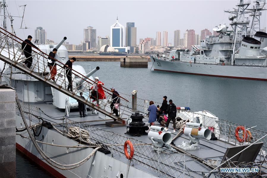 People visit a ship in the Chinese Navy Museum in Qingdao, east China\'s Shandong Province, April 16, 2019. (Xinhua/Li Ziheng)
