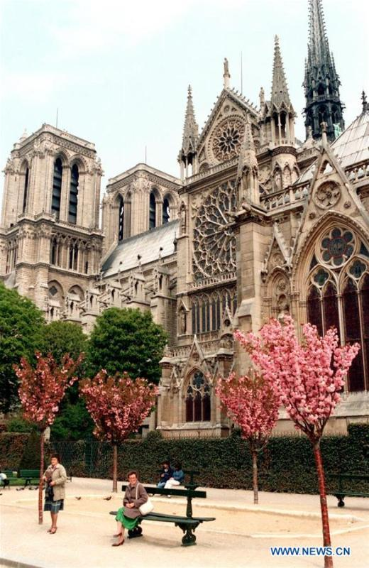 File photo taken in May of 1986 shows the Notre Dame Cathedral in Paris, France. The devastating fire at Notre Dame Cathedral in central Paris has been put out after burning for 15 hours, local media reported on April 16, 2019. In early evening on April 15, a fire broke out in the famed cathedral. Online footage showed thick smoke billowing from the top of the cathedral and huge flames between its two bell towers engulfing the spire and the entire roof which both collapsed later. Notre Dame is considered one of the finest examples of French Gothic architecture which receives about 12 million visitors every year. (Xinhua/Mu Qing)