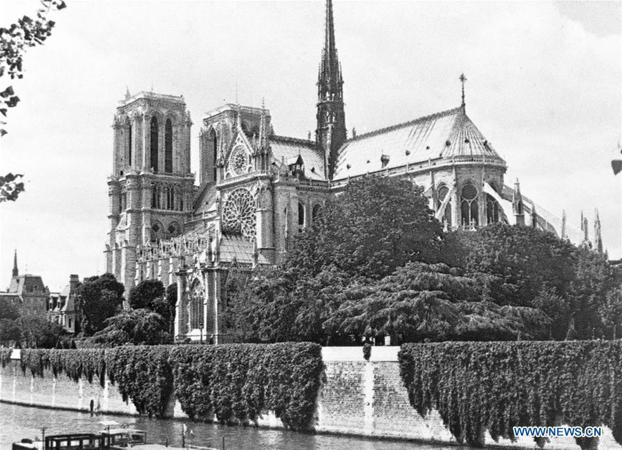 File photo taken in 1979 shows the Notre Dame Cathedral in Paris, France. The devastating fire at Notre Dame Cathedral in central Paris has been put out after burning for 15 hours, local media reported on April 16, 2019. In early evening on April 15, a fire broke out in the famed cathedral. Online footage showed thick smoke billowing from the top of the cathedral and huge flames between its two bell towers engulfing the spire and the entire roof which both collapsed later. Notre Dame is considered one of the finest examples of French Gothic architecture which receives about 12 million visitors every year. (Xinhua)