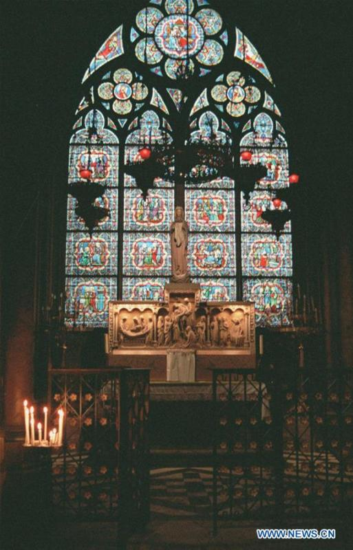 File photo taken in 2000 shows a stained-glass window depicting scenes from the Old Testament at the Notre Dame Cathedral in Paris, France. The devastating fire at Notre Dame Cathedral in central Paris has been put out after burning for 15 hours, local media reported on April 16, 2019. In early evening on April 15, a fire broke out in the famed cathedral. Online footage showed thick smoke billowing from the top of the cathedral and huge flames between its two bell towers engulfing the spire and the entire roof which both collapsed later. Notre Dame is considered one of the finest examples of French Gothic architecture which receives about 12 million visitors every year. (Xinhua/Xu Youzhu)