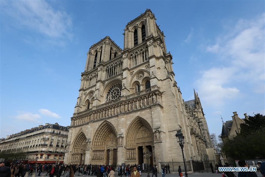 File photo taken on March 23, 2019 shows the exterior of the Notre Dame Cathedral in Paris, France. The devastating fire at Notre Dame Cathedral in central Paris has been put out after burning for 15 hours, local media reported on April 16, 2019. In early evening on April 15, a fire broke out in the famed cathedral. Online footage showed thick smoke billowing from the top of the cathedral and huge flames between its two bell towers engulfing the spire and the entire roof which both collapsed later. Notre Dame is considered one of the finest examples of French Gothic architecture which receives about 12 million visitors every year. (Xinhua/Zhang Cheng)