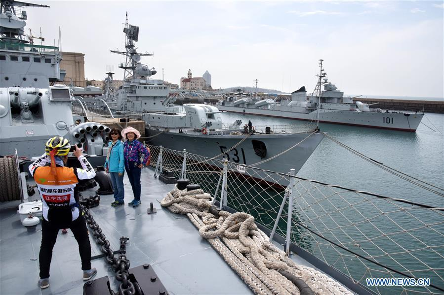 People take photos in the Chinese Navy Museum in Qingdao, east China\'s Shandong Province, April 16, 2019. (Xinhua/Li Ziheng)