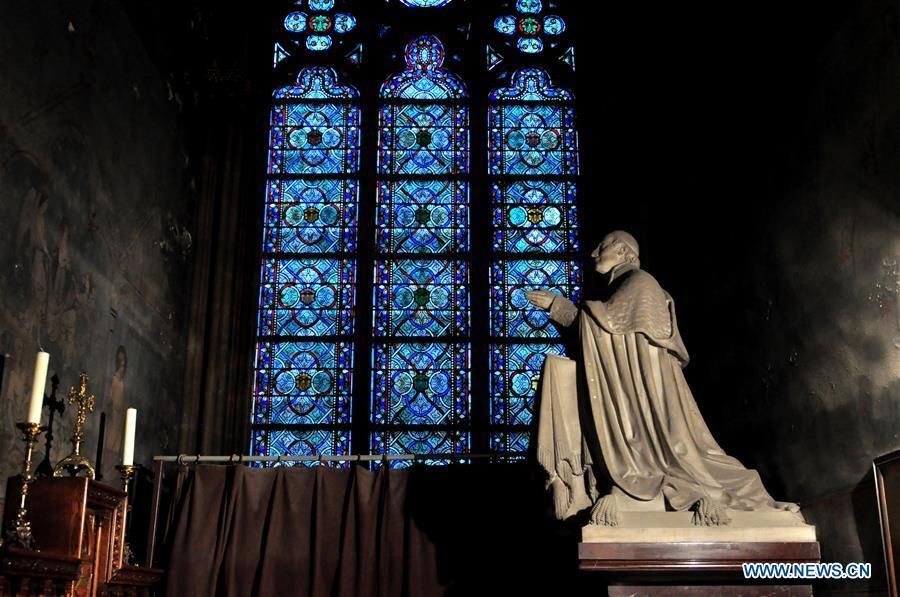 File photo taken on Oct. 11, 2013 shows exterior sculptures of the Notre Dame Cathedral in Paris, France. The devastating fire at Notre Dame Cathedral in central Paris has been put out after burning for 15 hours, local media reported on April 16, 2019. In early evening on April 15, a fire broke out in the famed cathedral. Online footage showed thick smoke billowing from the top of the cathedral and huge flames between its two bell towers engulfing the spire and the entire roof which both collapsed later. Notre Dame is considered one of the finest examples of French Gothic architecture which receives about 12 million visitors every year. (Xinhua/Liu Xiao)