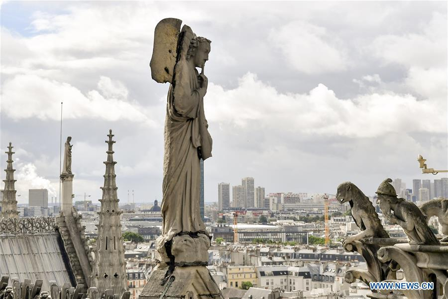 File photo taken on June 30, 2017 shows sculptures on the roof of the Notre Dame Cathedral in Paris, France. The devastating fire at Notre Dame Cathedral in central Paris has been put out after burning for 15 hours, local media reported on April 16, 2019. In early evening on April 15, a fire broke out in the famed cathedral. Online footage showed thick smoke billowing from the top of the cathedral and huge flames between its two bell towers engulfing the spire and the entire roof which both collapsed later. Notre Dame is considered one of the finest examples of French Gothic architecture which receives about 12 million visitors every year. (Xinhua/Chen Yichen)