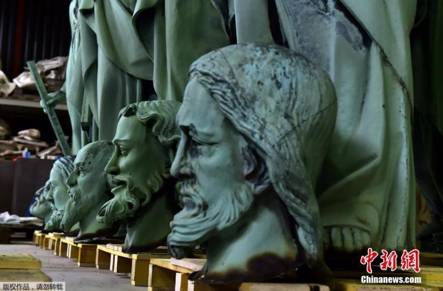 Photo taken in Marsac-sur-Isle near Bordeaux, on April 16, 2019 shows statues which sat around the spire of the Notre-Dame cathedral in Paris, stored in SOCRA workshop before restoration. (Photo/Agencies)