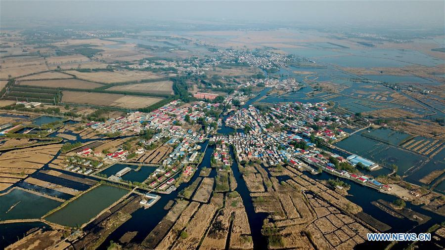 Aerial photo taken on April 10, 2019 shows the Zhaozhuangzi Village of Anxin County in Xiongan New Area, north China\'s Hebei Province. Restoration work has started in Baiyangdian Lake, northern China\'s largest freshwater body. High-pollution and energy-intensive production has been tackled. As a result, water quality has improved remarkably. (Xinhua/Mu Yu)