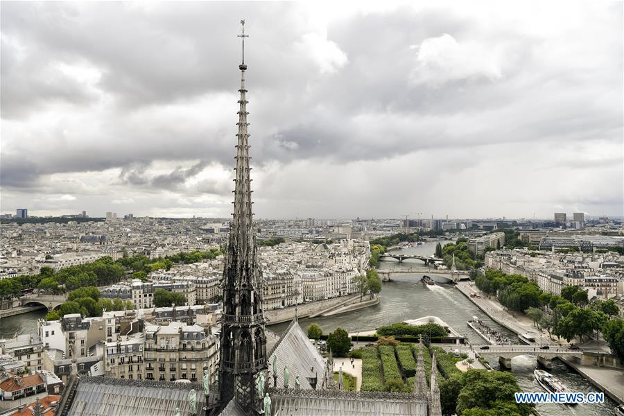File photo taken on June 30, 2017 shows the spire of the Notre Dame Cathedral in Paris, France. The devastating fire at Notre Dame Cathedral in central Paris has been put out after burning for 15 hours, local media reported on April 16, 2019. In early evening on April 15, a fire broke out in the famed cathedral. Online footage showed thick smoke billowing from the top of the cathedral and huge flames between its two bell towers engulfing the spire and the entire roof which both collapsed later. Notre Dame is considered one of the finest examples of French Gothic architecture which receives about 12 million visitors every year. (Xinhua/Chen Yichen)