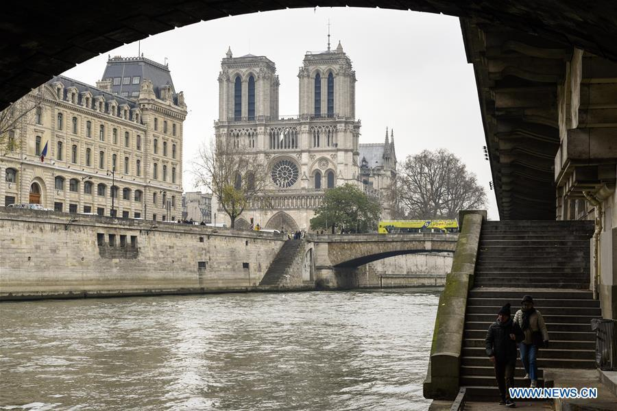 File photo taken on Dec. 2, 2016 shows the Notre Dame Cathedral by the River Seine in Paris, France. The devastating fire at Notre Dame Cathedral in central Paris has been put out after burning for 15 hours, local media reported on April 16, 2019. In early evening on April 15, a fire broke out in the famed cathedral. Online footage showed thick smoke billowing from the top of the cathedral and huge flames between its two bell towers engulfing the spire and the entire roof which both collapsed later. Notre Dame is considered one of the finest examples of French Gothic architecture which receives about 12 million visitors every year. (Xinhua/Chen Yichen)