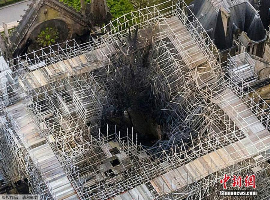 Aerial photo reveals the roof of the building was destroyed by the blaze, which burned for nine hours before being extinguished. The French president, Emmanuel Macron, has vowed to rebuild the Paris landmark within five years. The fire started at the base of the 93-metre spire and spread through the cathedral\'s ribbed roof, made up of hundreds of oak beams, some dating back to the 13th century. (Photo/Agencies)