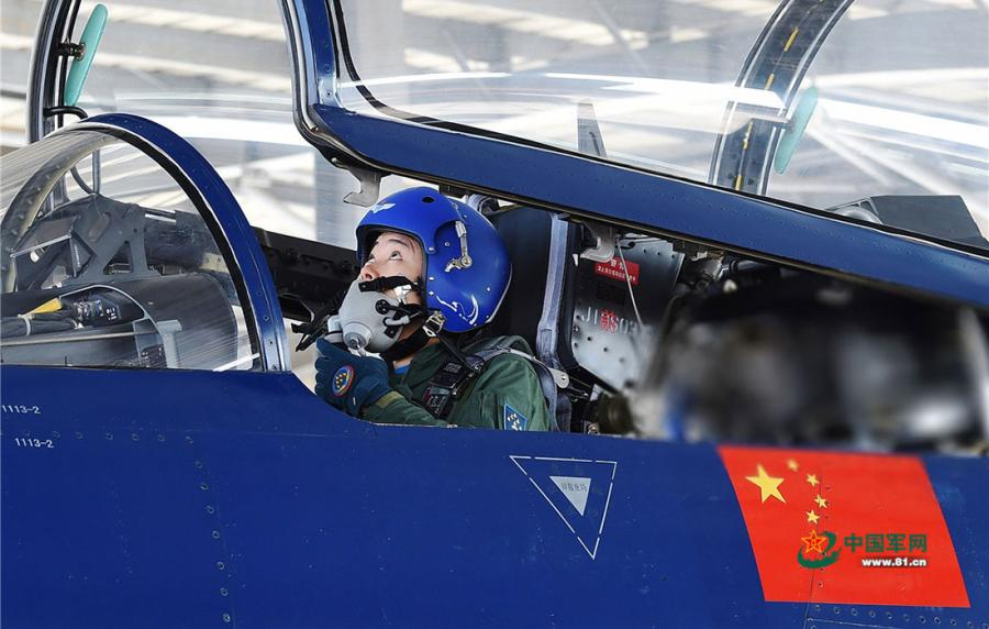 He Xiaoli, a female pilot, double-checks cockpit instruments before canopy is closed on April 10, 2019.