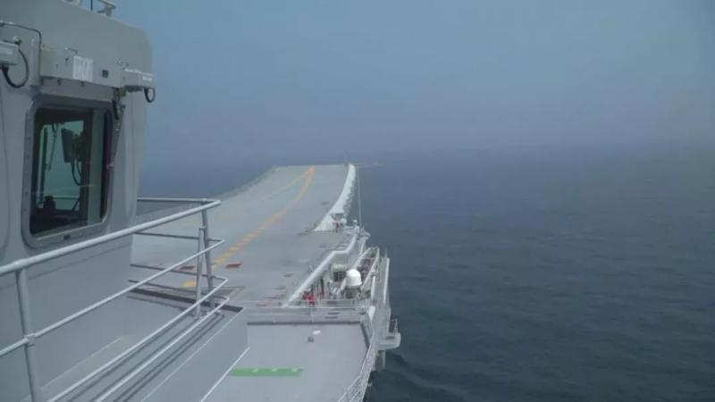 A photo of China\'s first domestically made aircraft carrier during its fifth sea trial. (Photo/CCTV)