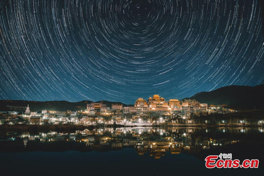 Stars in the night sky over the Ganden Sumtseling Monastery, the largest Tibetan Buddhist temple in Yunnan Province. (Photo/IC)