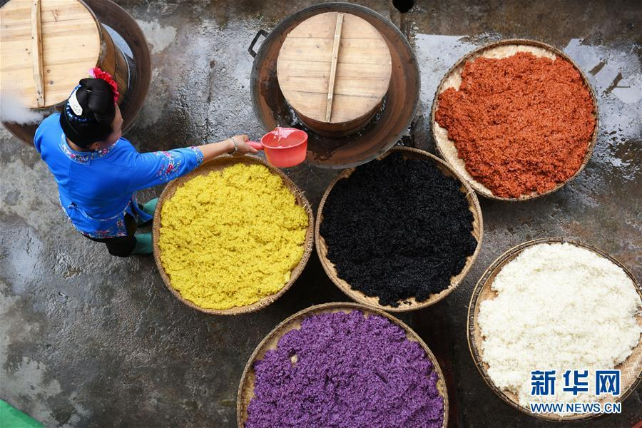 Women of Miao ethnic group made colorful sister rice to celebrate the Sister Meal Festival at Taijiang County, south China\'s Guizhou Province on April 17, 2019. (Photo/Xinhua)