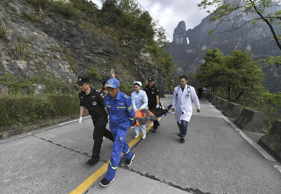 Rescue workers carry a \