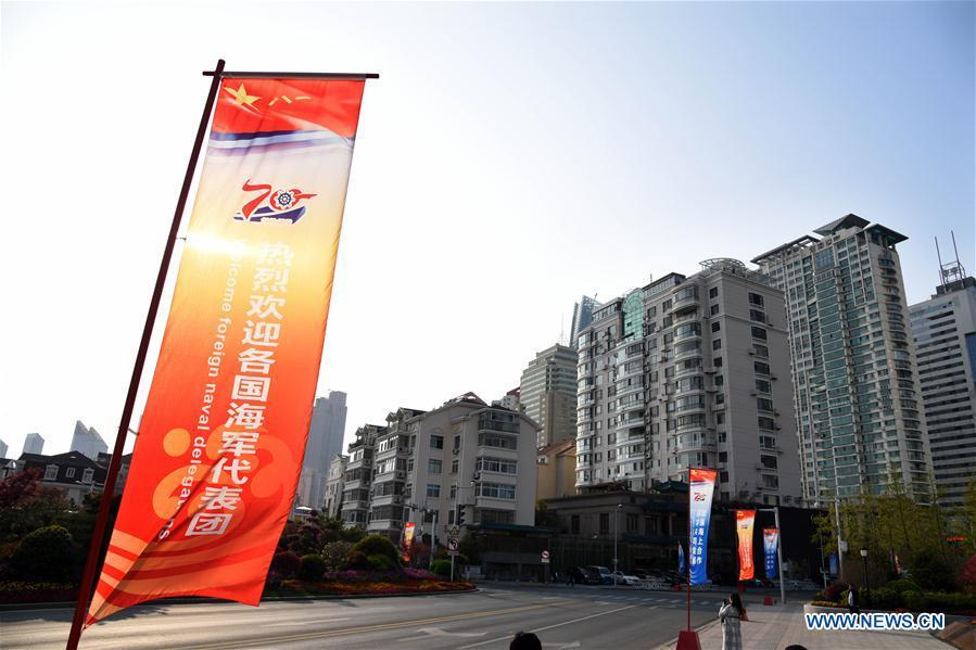 Photo taken on April 17, 2019 shows the signs celebrating the 70th founding anniversary of the People\'s Liberation Army (PLA) Navy in Macao Road of Qingdao, east China\'s Shandong Province. April 23 is the 70th founding anniversary of the PLA Navy, and a commemorative event will be held in the eastern coastal city of Qingdao. (Xinhua/Li Ziheng)