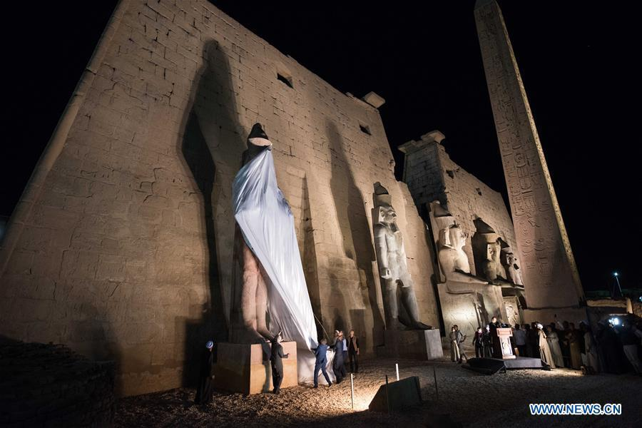 People attend the unveiling of a colossus of ancient Egyptian King Ramses II at Luxor Temple in Luxor, Egypt, April 18, 2019. Egypt\'s Ministry of Antiquities unveiled on Thursday evening a 60-ton statue of ancient Egyptian King Ramses II at the Luxor Temple after its restoration and re-erection on the Nile River\'s east bank in the southern province of Luxor. (Xinhua/Meng Tao)