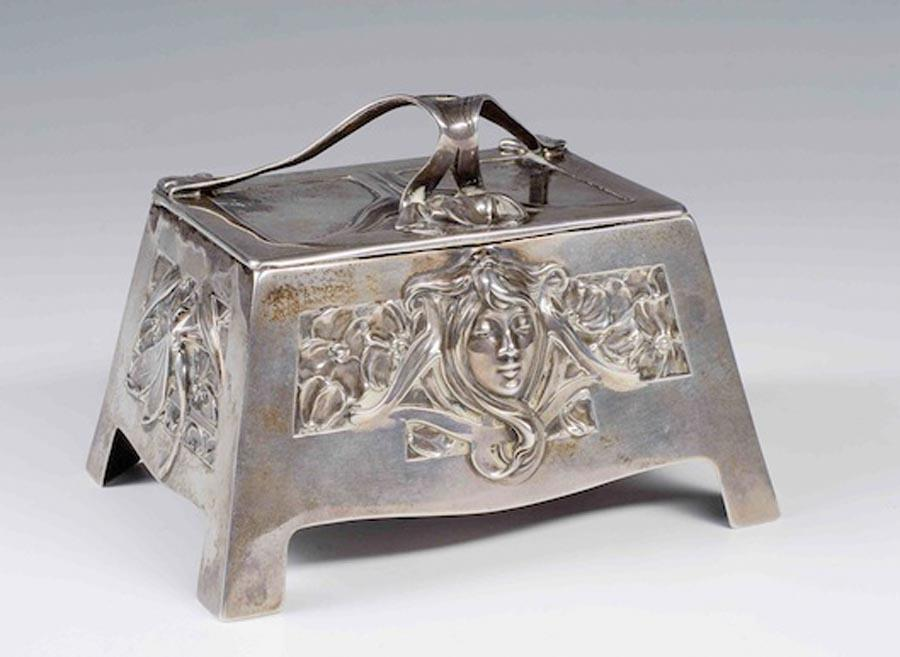 A silver box with the pattern of a girl\'s head that\'s named after Mucha. (Photo provided to China Daily) During the exhibition, the Pearl Art Museum will organize a series of programs, including lectures and workshops presented by scholars and designers in art, history and culture. Lectures will also be held at colleges and universities around the Yangtze River Delta.  Gifts bearing Mucha designs, such as Czech crystal products, silk scarves, and other creative supplies, are available at the Life and Art boutique, or LAb, at the museum.  The museum has also compiled the exhibition catalogue Mucha in both Chinese and English. The book is available at LAb, its online store, as well as Xinhua Bookstores around China.