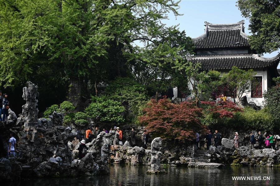 People visit the Lion Forest Garden in Suzhou, east China\'s Jiangsu Province, April 17, 2019. Suzhou is home to dozens of famous classical gardens that have inventive and exquisite design and oriental aesthetics. Nowadays more than 60 of them are still in existence, among which the Humble Administrator\'s Garden, Lingering Garden and the Lion Grove Garden are on the UNESCO\'s World Heritage List. (Xinhua/Li Xiang)