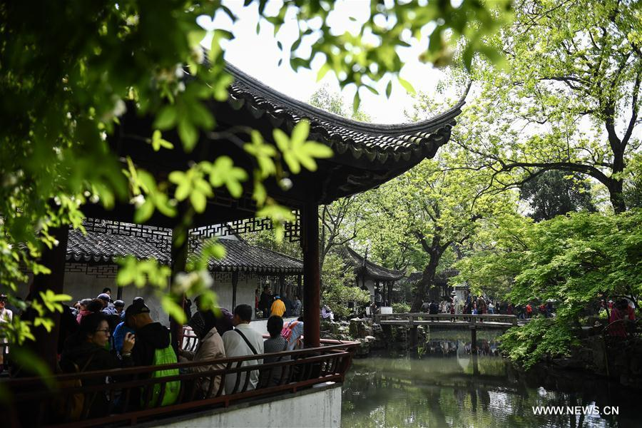 People visit the Humble Administrator\'s Garden in Suzhou, east China\'s Jiangsu Province, April 17, 2019. Suzhou is home to dozens of famous classical gardens that have inventive and exquisite design and oriental aesthetics. Nowadays more than 60 of them are still in existence, among which the Humble Administrator\'s Garden, Lingering Garden and the Lion Grove Garden are on the UNESCO\'s World Heritage List. (Xinhua/Li Xiang)