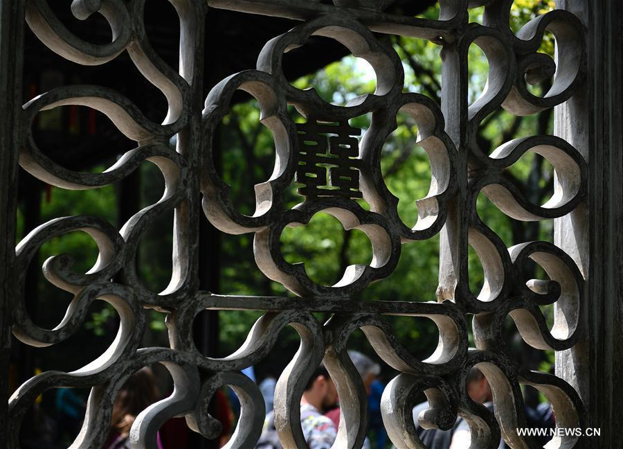 Photo taken on April 17, 2019 shows the decorations in Humble Administrator\'s Garden in Suzhou, east China\'s Jiangsu Province. Suzhou is home to dozens of famous classical gardens that have inventive and exquisite design and oriental aesthetics. Nowadays more than 60 of them are still in existence, among which the Humble Administrator\'s Garden, Lingering Garden and the Lion Grove Garden are on the UNESCO\'s World Heritage List. (Xinhua/Li Xiang)
