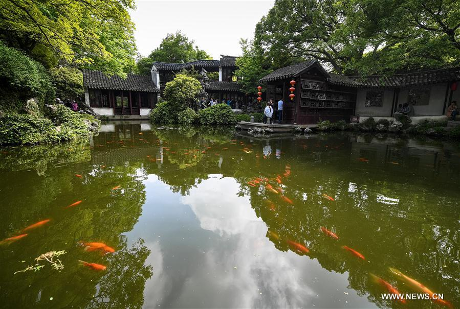 People visit the Retreat &Reflection Garden in Suzhou, east China\'s Jiangsu Province, April 19, 2019. Suzhou is home to dozens of famous classical gardens that have inventive and exquisite design and oriental aesthetics. Nowadays more than 60 of them are still in existence, among which the Humble Administrator\'s Garden, Lingering Garden and the Lion Grove Garden are on the UNESCO\'s World Heritage List. (Xinhua/Li Xiang)