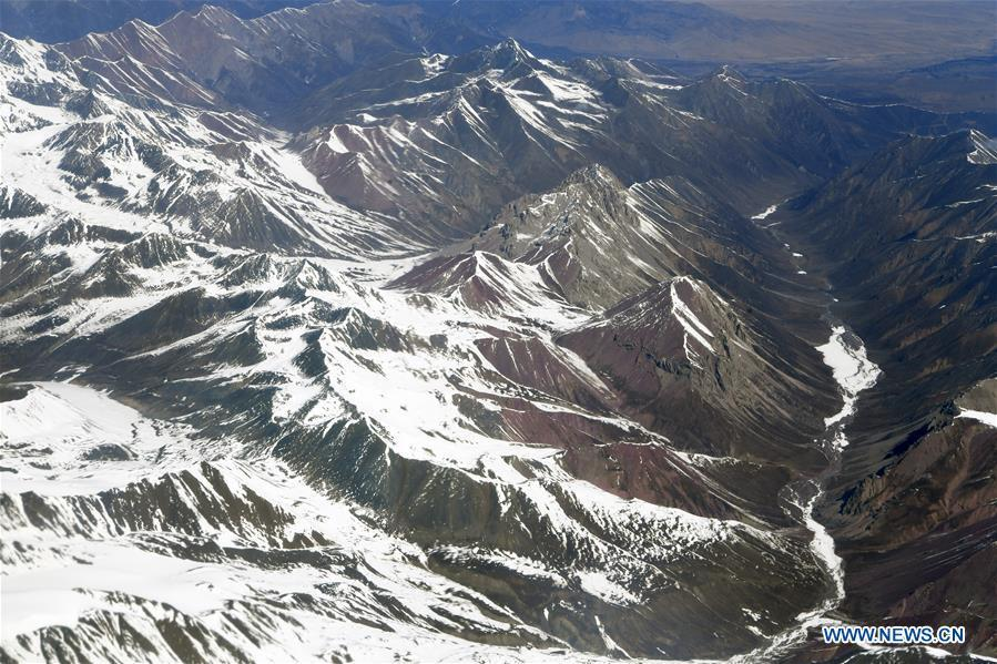Aerial photo taken on April 21, 2019 shows the snow scenery of Qilian Mountains in northwest China. (Xinhua/Fan Peishen)