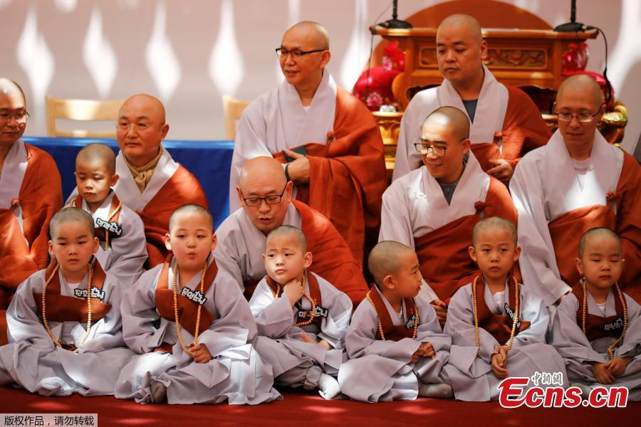 Young novice monks gather after having their heads shaved during the \'Children becoming Buddhist monks\' ceremony at the Jogyesa temple in Seoul, South Korea, April 22, 2019. The children will stay at the temple to learn about Buddhism for 21 days. South Korean Buddhists prepare to celebrate Buddha\'s upcoming birthday on May 12, 2019. (Photo/Agencies)