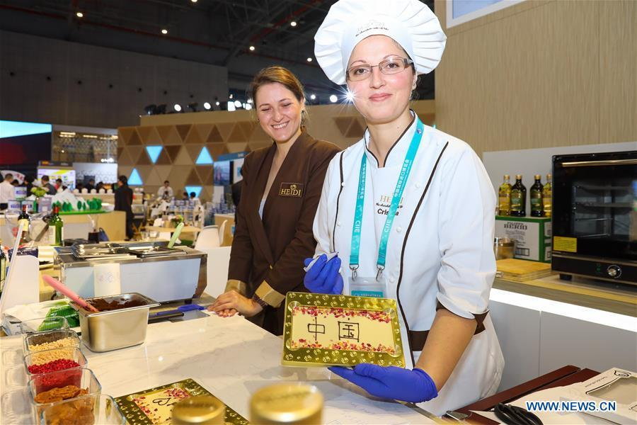 Exhibitors of Swiss chocolate maker Heidi shows a bar of chocolate with the pattern reading \