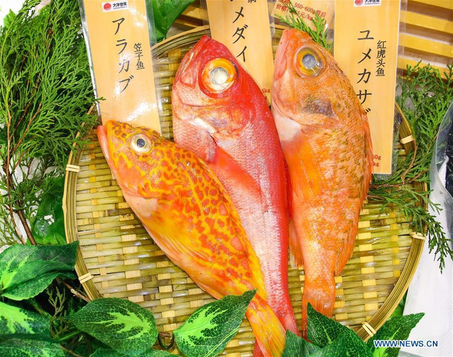 Photo taken on Nov. 7, 2018 shows sea food from Japan at the Food & Agricultural Products area during the first China International Import Expo (CIIE) in Shanghai, east China. Food of a particular place is an important symbol of local geographic and cultural characteristics. Food carries history and tradition, leads the tide of trade, strengthens diplomatic relations, disseminates and promotes culture. Food has been serving as connections between people around the world. In ancient times, food such as grapes, pomegranates, walnuts, coriander, cucumbers and sesame seeds were introduced to China along the Silk Road. Nowadays, thanks to the Belt and Road Initiative, red wine, coffee, dried fruits, meat, seafood, and dairy products from foreign countries enter the homes of ordinary people, turning daily meals into feasts with exotic cuisines. (Xinhua/Liu Dawei)