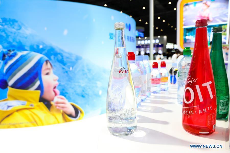 Photo taken on Nov. 7, 2018 shows bottled water and Aquadrink of Danone displayed at the Food & Agricultural Products area of the first China International Import Expo (CIIE) in Shanghai, east China. Food of a particular place is an important symbol of local geographic and cultural characteristics. Food carries history and tradition, leads the tide of trade, strengthens diplomatic relations, disseminates and promotes culture. Food has been serving as connections between people around the world. In ancient times, food such as grapes, pomegranates, walnuts, coriander, cucumbers and sesame seeds were introduced to China along the Silk Road. Nowadays, thanks to the Belt and Road Initiative, red wine, coffee, dried fruits, meat, seafood, and dairy products from foreign countries enter the homes of ordinary people, turning daily meals into feasts with exotic cuisines. (Xinhua/Liu Dawei)