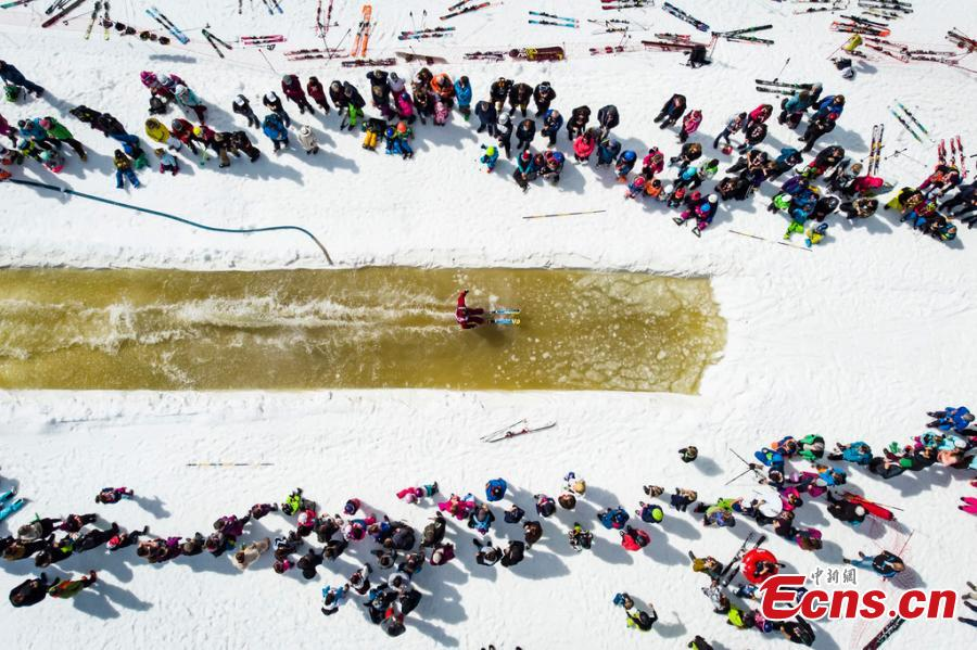 A skier participates in a waterslide contest at the \