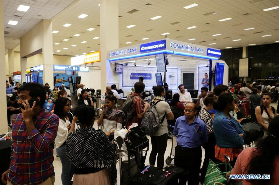 Passengers queue up for taxi at the Bandaranaike International Airport in Colombo, Sri Lanka, April 22, 2019. The death toll from the multiple blasts that ripped through Sri Lanka on Sunday rose to 228 while 450 others were injured, local media quoting hospital sources said. (Xinhua/Wang Shen)