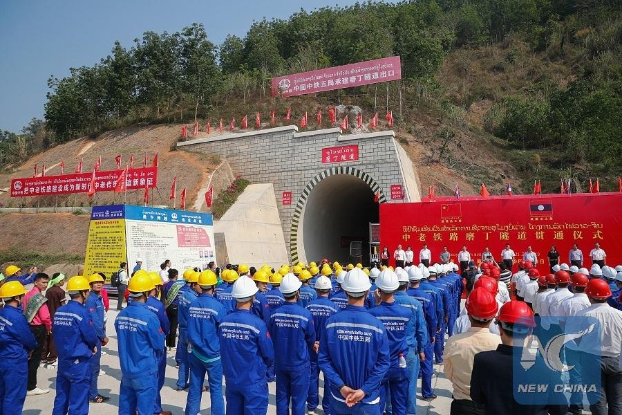 A photo taken on March 21, 2019 shows the drilling-through ceremony of Boten Tunnel along the China-Laos railway in Boten, Laos. (Photo/Xinhua)  China-Laos Railway  The 414-km China-Laos Railway runs from Boten, the northern Lao town bordering Southwest China\'s Yunnan province, to Vientiane, capital of Laos, with an operating speed of 160 km per hour.  The electrified passenger and cargo railway, which started construction in December 2016 with the full application of Chinese management standards and technical standards, is scheduled to be completed and open to traffic in December 2021.  It is a strategic project aligning the China-proposed Belt and Road Initiative and Laos\' strategy to convert from a landlocked country to a land-linked hub.