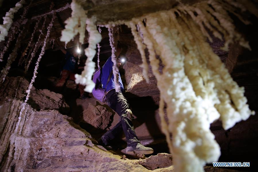 Cavers explore the Malham cave near the Dead Sea in southeastern Israel on April 14, 2019. Israeli and European researchers have discovered the world\'s deepest salt cave, Malham Cave with a depth of at least 10 kilometers, near the Dead Sea, said a report issued Thursday by the Hebrew University of Jerusalem. The researchers re-measured the 7,000-year-old Malham Cave, near the Dead Sea in southeastern Israel, and found that it is much longer than 5.5 kilometers as previously thought. Thus, the Israeli cave bypasses Iran\'s Cave of the Three Nudes (3N) on Qeshm Island, which since 2006 has been considered the world\'s deepest salt cave with a depth of 6.58 kilometers. (Xinhua/Gil Cohen Magen)