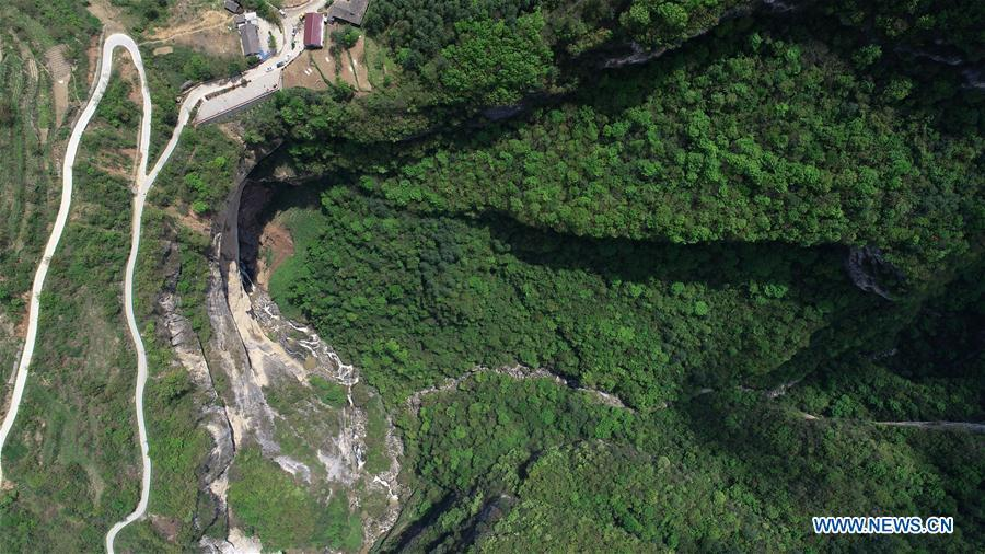 Aerial photo taken on April 22, 2019 shows the Didonghe Tiankeng, a giant karst sinkhole at Huoshizi Village of Ningqiang County in Hanzhong, northwest China\'s Shaanxi Province. With a maximum depth of 340 meters, the Didonghe Tiankeng is the largest in Chanjiayan Tiankeng Group in Ningqiang County. (Xinhua/Zhang Bowen)
