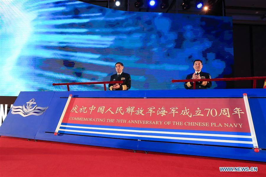 Commander of the Chinese People\'s Liberation Army (PLA) Navy Shen Jinlong (L) and Political Commissar of the PLA Navy Qin Shengxiang attend the opening ceremony of the multinational naval events commemorating the 70th founding anniversary of the PLA Navy in Qingdao, east China\'s Shandong Province, April 22, 2019. (Xinhua/Ju Zhenhua)