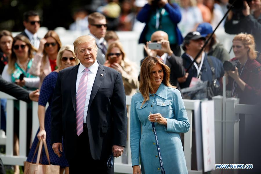 U.S. President Donald Trump (front L) and First Lady Melania Trump (front R) attend the annual Easter Egg Roll at the White House in Washington D.C., the United States, on April 22, 2019. White House Easter Egg Roll was held on the South Lawn on Monday as the annual tradition entered its 141st year. (Xinhua/Ting Shen)