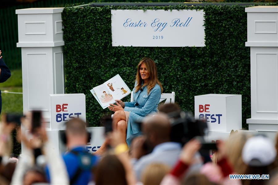 U.S. First Lady Melania Trump reads a children\'s book during the annual Easter Egg Roll at the White House in Washington D.C., the United States, on April 22, 2019. White House Easter Egg Roll was held on the South Lawn on Monday as the annual tradition entered its 141st year. (Xinhua/Ting Shen)