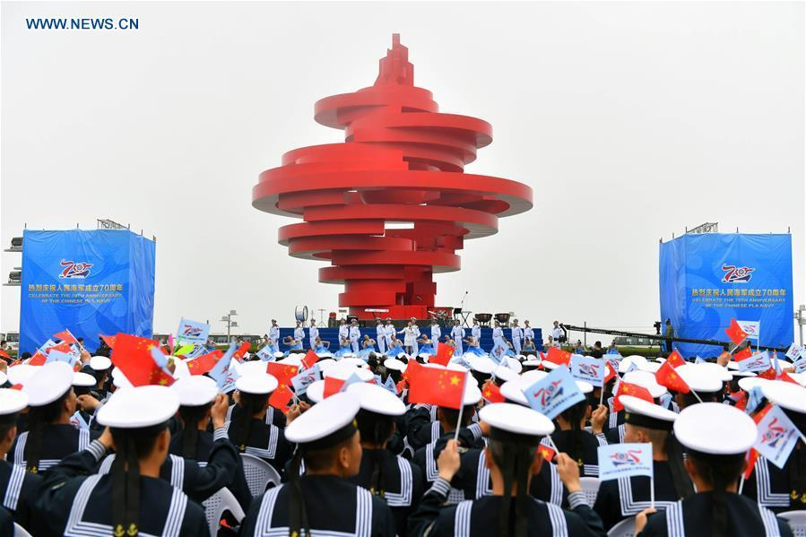A joint military music display is held to celebrate the People\'s Liberation Army Navy\'s 70th founding anniversary in Qingdao, east China\'s Shandong Province, April 22, 2019. The military bands from the navies of China, Thailand, Vietnam, Bangladesh and India performed at the event. Over 1,200 people, including officers and soldiers of navy vessels from home and abroad and Qingdao citizens, viewed the performance. (Xinhua/Zhu Zheng)