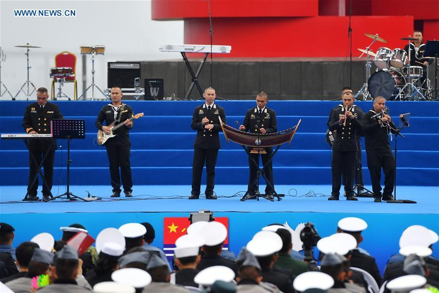 A military band from Thailand performs during a joint military music display held to celebrate the People\'s Liberation Army Navy\'s 70th founding anniversary in Qingdao, east China\'s Shandong Province, April 22, 2019. The military bands from the navies of China, Thailand, Vietnam, Bangladesh and India performed at the event. Over 1,200 people, including officers and soldiers of navy vessels from home and abroad and Qingdao citizens, viewed the performance. (Xinhua/Zhu Zheng)