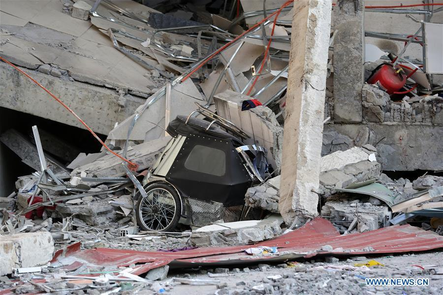 A tricycle is seen under a collapsed building in Pampanga Province, the Philippines, April 23, 2019. The death toll from the 6.1-magnitude earthquake that struck the Philippines\' main Luzon Island rose to nine, local officials said on Tuesday. (Xinhua/Rouelle Umali)