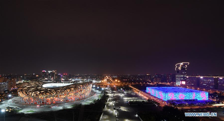 Photo taken on April 10, 2019 shows the night view of the National Stadium (L), also known as the Bird\'s Nest, and the National Aquatics Center, or the Water Cube, in Beijing, capital of China. The second Belt and Road Forum for International Cooperation is to be held on April 25-27 in Beijing. (Xinhua/Chen Yehua)